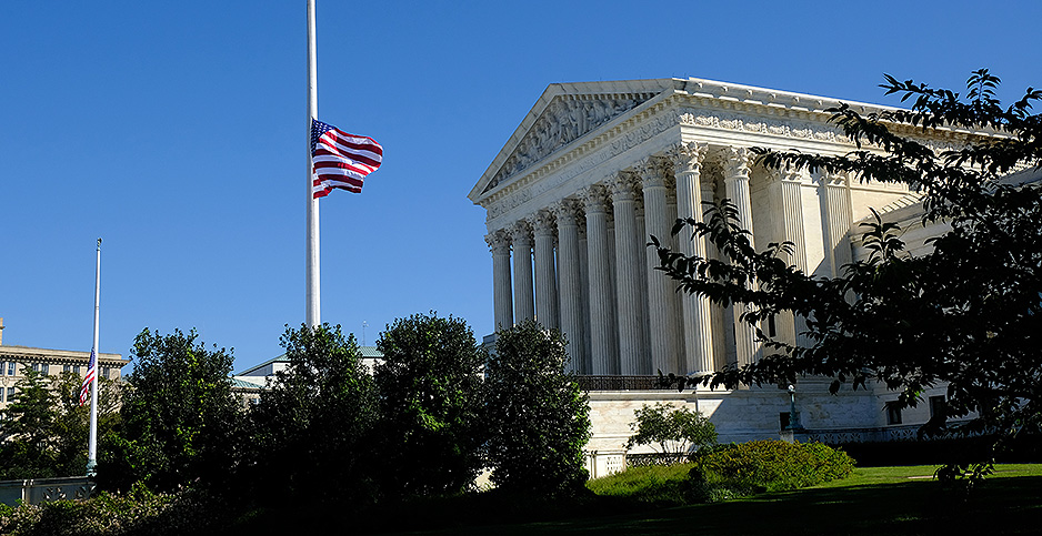 Supreme Court with flag flying at half-staff. Photo credit: Leigh Green/SplashNews/Newscom