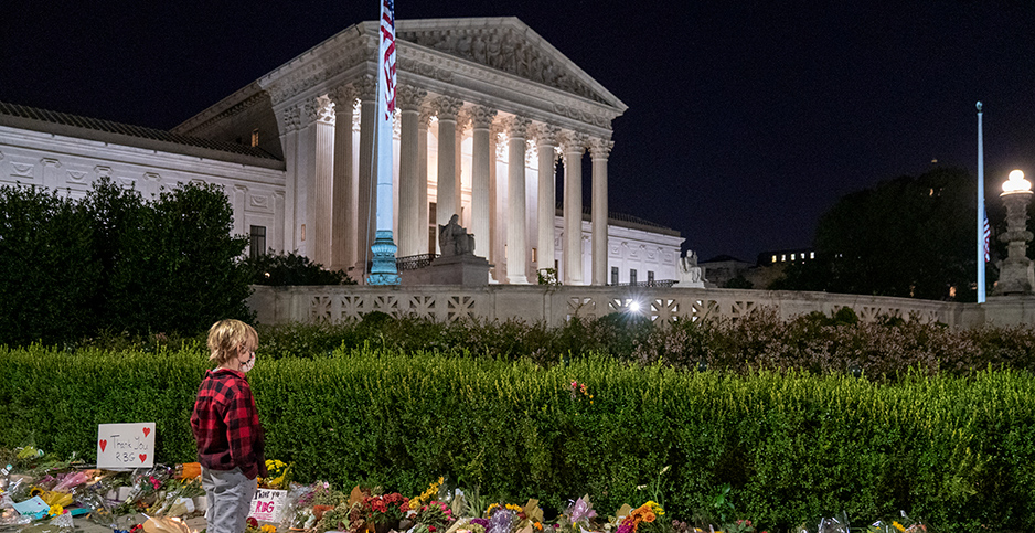 Miles Flynn, 10, views the thousands of flowers and trinkets left near the steps of the Supreme Court as mourners pay their respects for Supreme Court Justice Ruth Bader Ginsburg. Photo credit: Ken Cedeno/UPI/Newscom