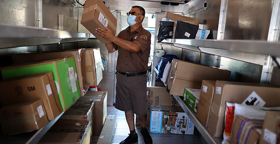UPS Driver in an electric UPS truck. Photo credit: Lucy Nicholson/Reuters/Newscom