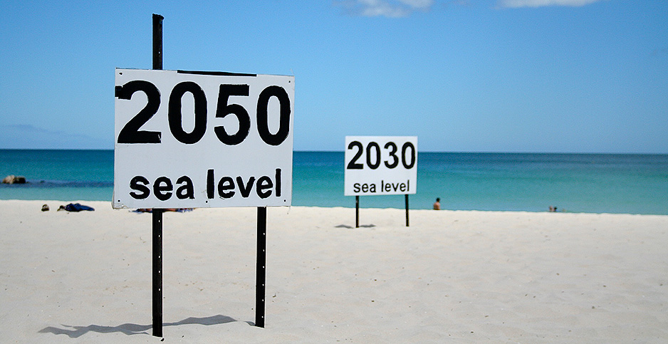 Two signs at at Cottesloe Beach in western Australia project future sea levels. Photo credit: go_greener_oz/Flickr
