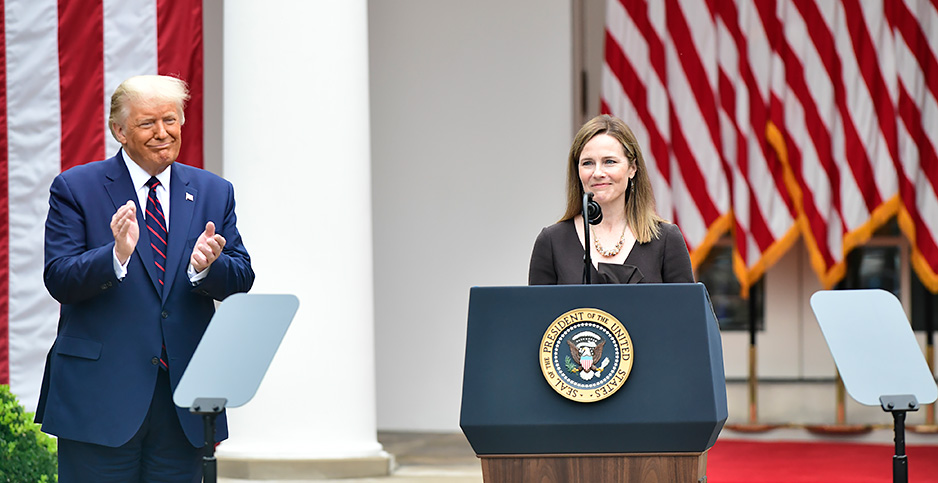 President Donald Trump claps for Judge Amy Coney Barrett, his latest Supreme Court nominee, in a ceremony Saturday at the White House. Photo credit: SplashNews/Newscom