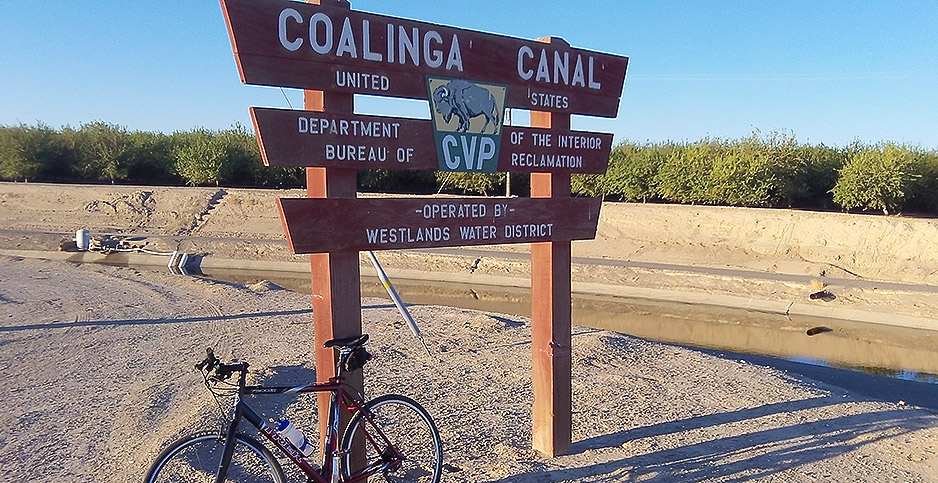 Coalinga Canal sign in front of canal and almond orchard. Photo credit: Hasso Hering/hh-today.com