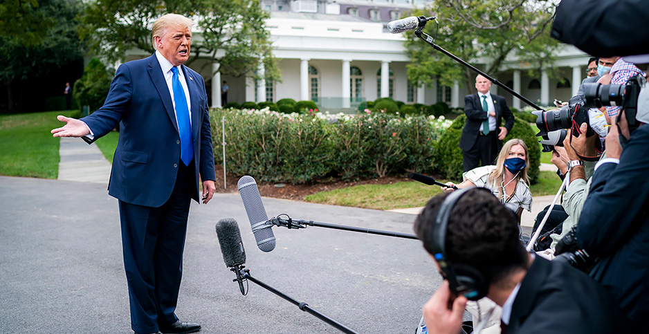 President Donald Trump speaks to journalists the South Lawn driveway. Photo credit: Tia Dufour/The White House/Flickr