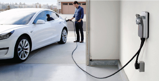 Man charging electric car. Photo credit: Chargepoint