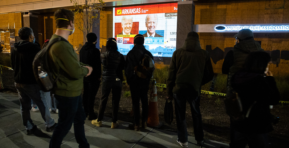 Protesters watch the U.S. presidential election results roll in Nov. 3 near the White House in Washington, D.C. Photo credit: Francis Chung/E&E News