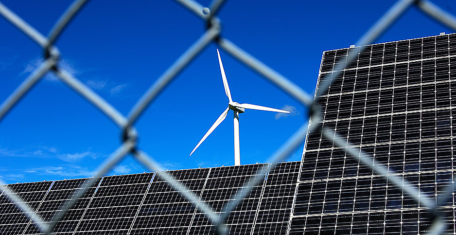 Solar and wind installation behind fencing in Switzerland. Photo credit: GFC Collection/agefotostock/Newscom