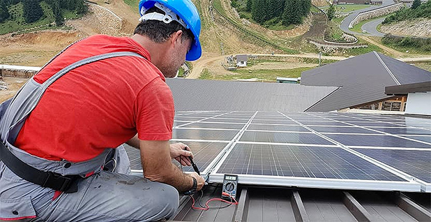 Rooftop solar installer. Photo credit: Pikist