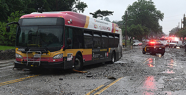 Several people had to be rescued off this flooded MTA bus at Frederick Avenue at Long Island Ave in Baltimore, Md. during a May 2018 storm. Photo credit: Jerry Jackson/Baltimore Sun/TNS/Newscom