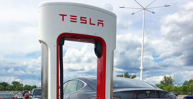 Tesla car and supercharger. Photo credit: @Tesla/Twitter