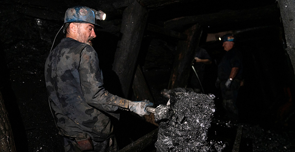 A worker loads a coal cart in an underground anthracite mine in Silver Creek, Pennsylvania. Photo credit: Dane Rhys/REUTERS/Newscom