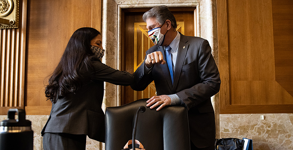 Sen. Joe Manchin (D-W.Va.) and Rep. Deb Haaland (D-N.M.). Photo credit: CNP/Polaris/Newscom
