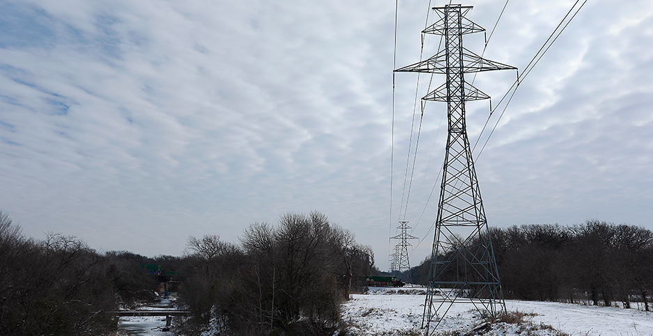Texas transmission line in snow. Photo credit: Ralph Lauer/ZUMAPRESS/Newscom