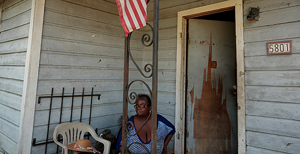 Woman on her porch after Hurricane Harvey. Photo credit: Chris Aluka Berry/REUTERS/Newscom