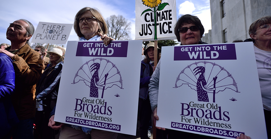 "Women holding ""Great Old Broads For Wilderness"" signs. Photo credit: Alex Milan Tracy/Sipa USA/Newscom"
