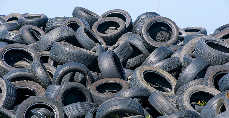 The sun beats down on a pile of used tires in Cape Town, South Africa. Photo credit: Rodger Shagam/agefotostock/Newscom