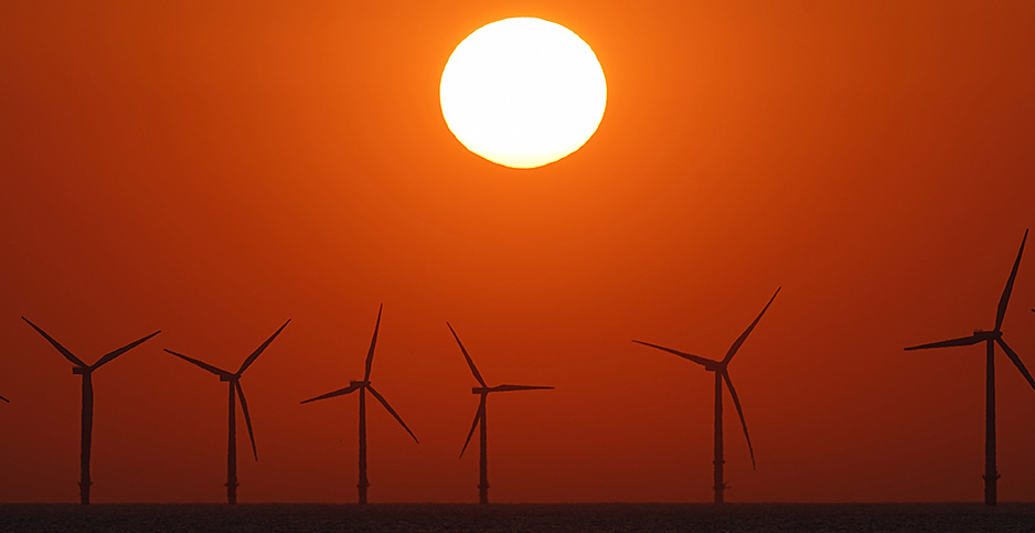 The sun sets behind the wind turbines of Burbo Bank Offshore Wind Farm in this 2018 file photo. Photo credit: Christopher Furlong/Getty Images