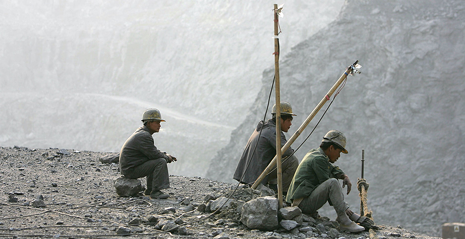 Workers take a break at a cement factory mine in the Guangdong Province of China. Photo credit: Cancan Chu/Getty Images
