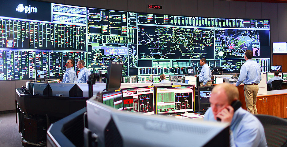 Grid operators monitoring electricity use in a control room in PJM Interconnection's headquarters near Valley Forge, Pa. Credit: PJM Interconnection